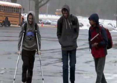 Students Traversing Bus Parking Lot